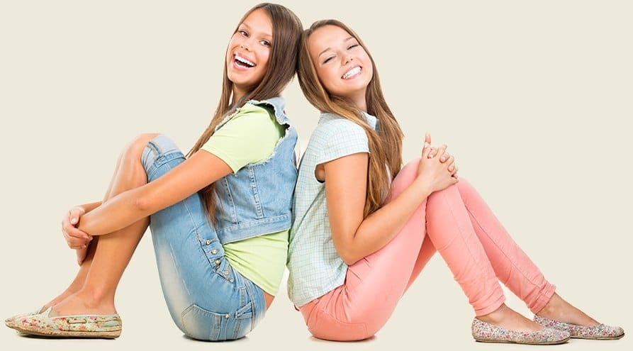 Two smiling teen girls