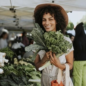 happy person shopping at a farmers market