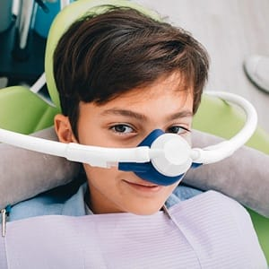 Young boy receiving nitrous oxide from sedation dentist in Lincoln